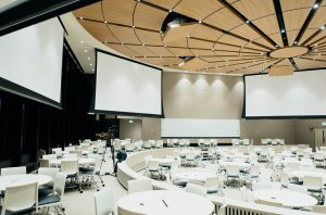 white projector screens in conference room